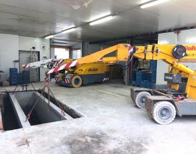Déchargement, manutention et mise en fouille d'une fosse de graissage dans un bâtiment industriel